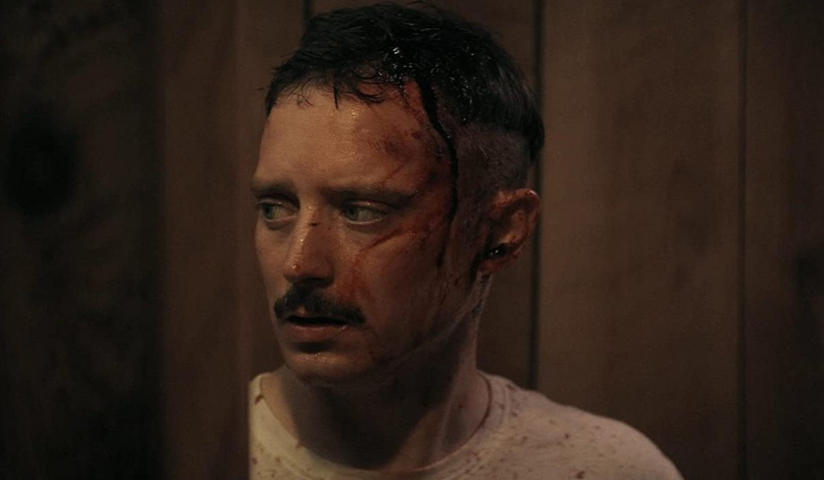 Come To Daddy Elijah Wood with a bleeding head wound