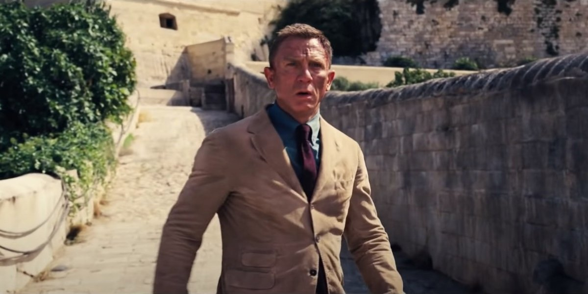 Daniel Craig looks scuffed up on the bridge in No Time To Die.