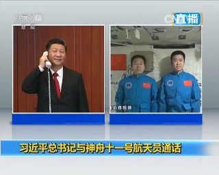 China's president Xi Jinping calls astronauts Jing Haipeng and Chen Dong aboard the Tiangong-2 space laboratory during their long-duration space mission.