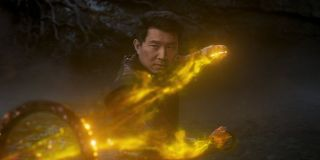 Simu Liu wielding the Ten Rings in gold light in Shang-Chi and the Legend of the Ten Rings.