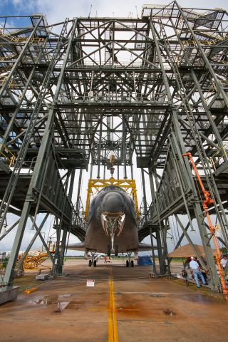The nose landing gear of space shuttle Endeavour is lifted during operations to raise the shuttle for securing to the Shuttle Carrier Aircraft on Sept. 14, 2012.