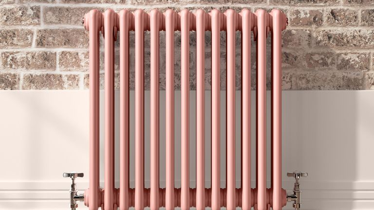 Radiator against brick wall by Soak