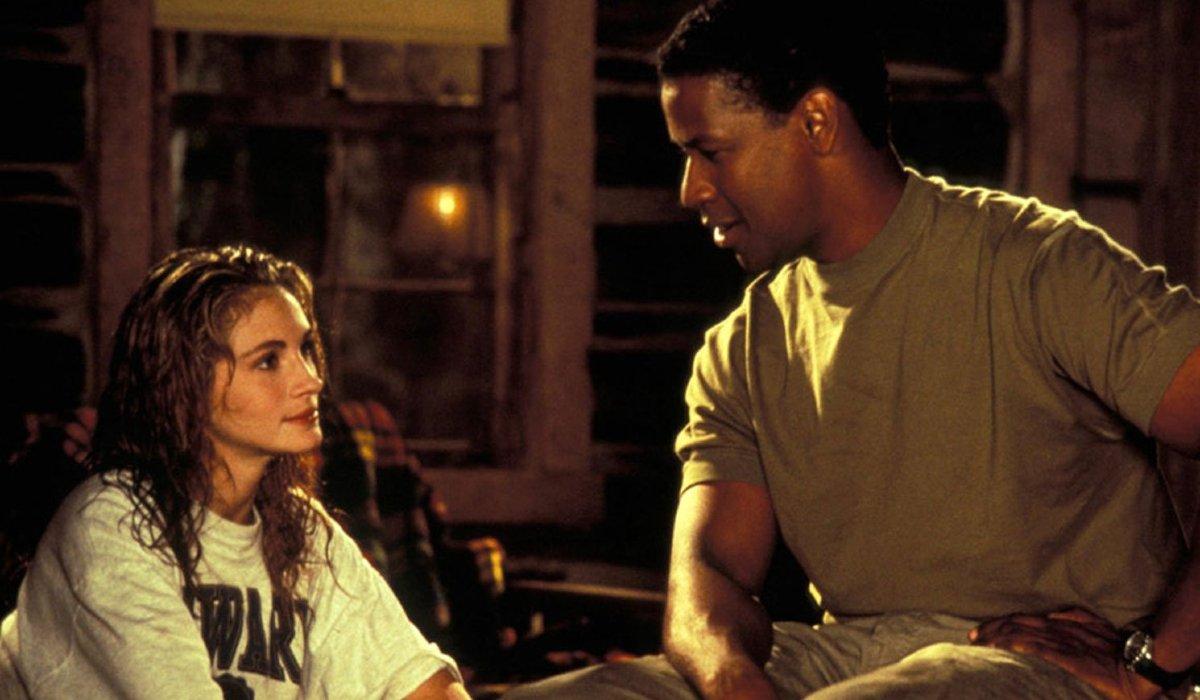 Denzel Washington talks to Julia Roberts in a log cabin in The Pelican Brief.