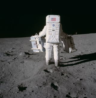 In this image taken during the Apollo 11 mission, astronaut Buzz Aldrin moves toward a position to deploy two components of the Early Apollo Scientific Experiments Package (EASEP) on the surface of the moon.
