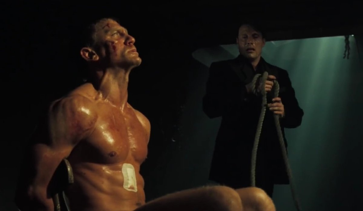 Daniel Craig sits in a chair as he's tortured by Mads Mikkelsen in Casino Royale.