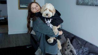 Venom Prison singer Larissa holding Barney the dog
