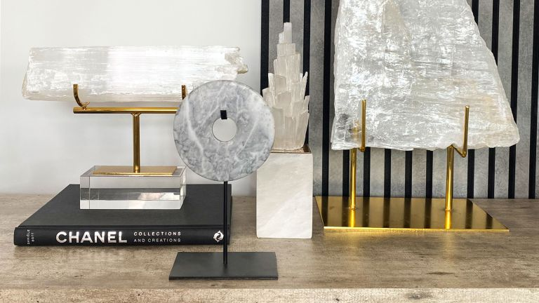 crystals on a desk with chanel coffee table book