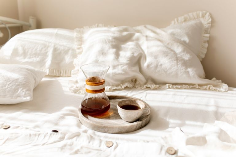 best mattress protector - coffee set up on bed