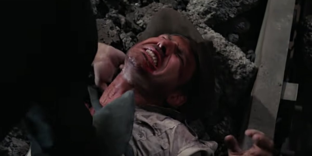 Harrison Ford in pain in Indiana Jones and the Temple of Doom