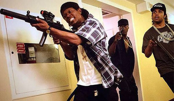 Eazy-E, Ice Cube and MC Ren pull guns in a hotel in Straight Out Of Compton