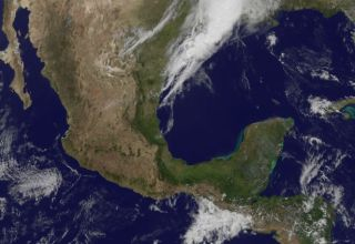 This visible image from NOAA's GOES-13 satellite was captured at 1815 UTC (2:15 p.m. EST), just 13 minutes after the 7.6 magnitude earthquake centered in southwestern Mexico's Oaxaca state.