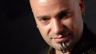 Disturbed singer David Draiman against a black background