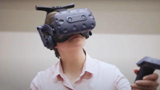 Dr Natasha Taylor using a VR headset at Coventry University.