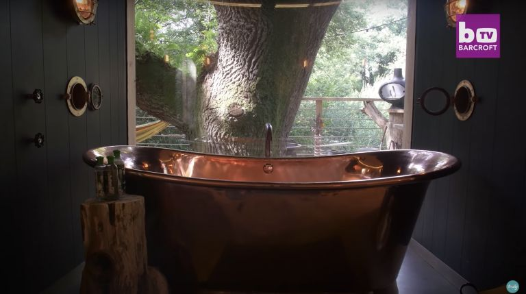 copper freestanding bath tub in a luxury treehouse in Dorset