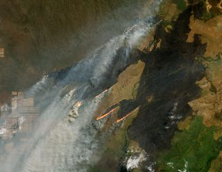 NASA's Operational Land Imager on Landsat 8 photographed several fires near the border of Bolivia, Paraguay and Brazil.