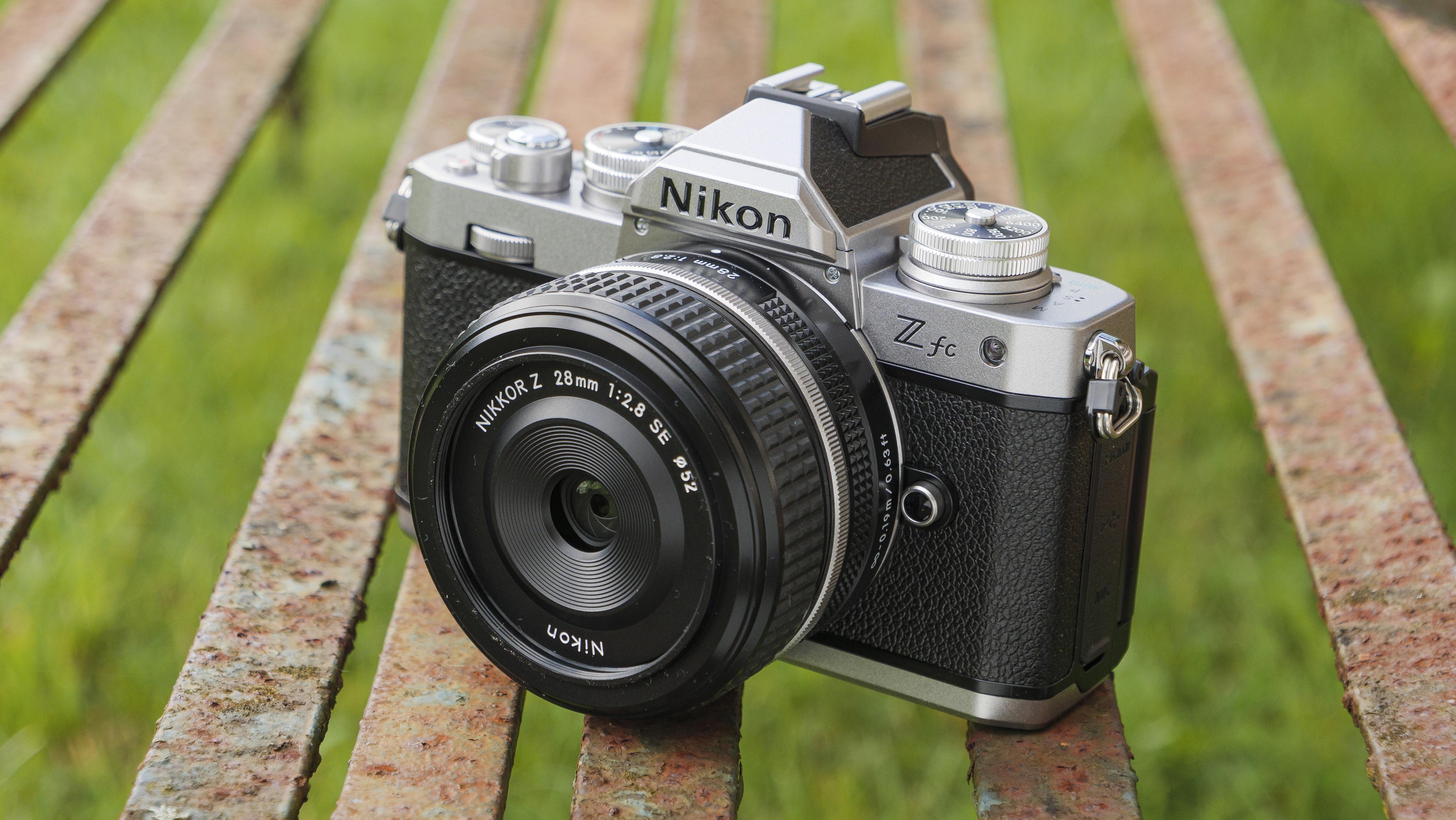 The Nikon Z fc camera on a park bench