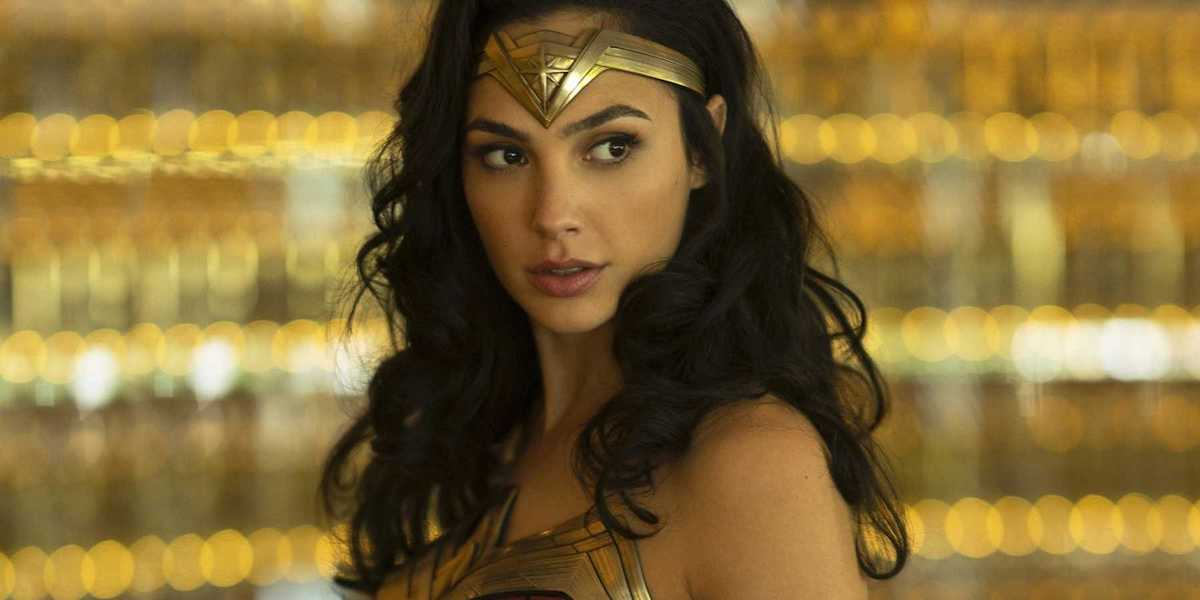 Wonder Woman (Gal Gadot) wears her costume in front of a blurry gold backdrop in an image from 'Wond