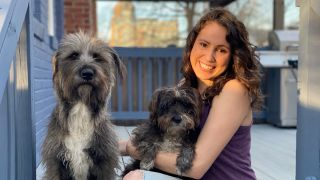It's all smiles today for Laura and her two adorable dogs, Azula and Evie