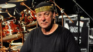 A portrait of Neil Peart with his drums