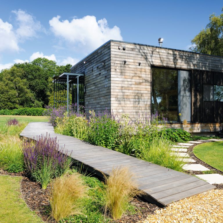 a timber clad mobile home in the New Forest