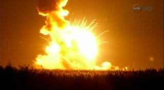 An Orbital Sciences Antares rocket explodes shortly after lifting off on a private cargo mission toward the International Space Station on Oct .28, 2014 from NASA's Wallops Flight Facility in Virginia.