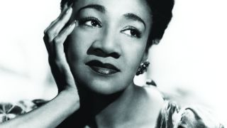 Alberta Hunter gazing to her left, resting her chin on her right hand.