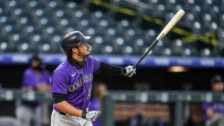 Rockies star Nolan Arenado admires his home run