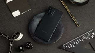 Samsung Galaxy A52 in black laying on a black desk