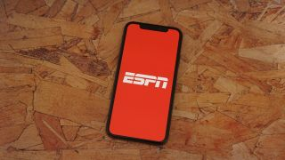 Smartphone on board with ESPN app loaded on the screen