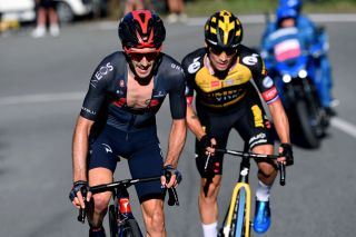MILAN ITALY OCTOBER 06 LR Adam Yates of United Kingdom and Team INEOS Grenadiers and Primoz Roglic of Slovenia and Team Jumbo Visma compete in the breakaway during the 102nd MilanoTorino 2021 a 190km race from Magenta to Torino Superga 669m MilanoTorino on October 06 2021 in Milan Italy Photo by Tim de WaeleGetty Images