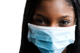 Health care worker wearing face mask.