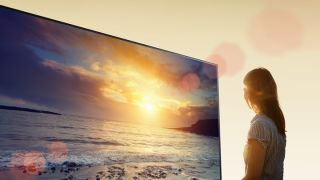 Woman looking at Sony A1E OLED TV