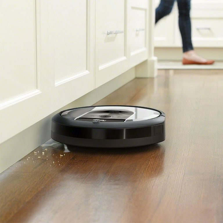 iRobot Roomba i6+ in kitchen picking up dirt
