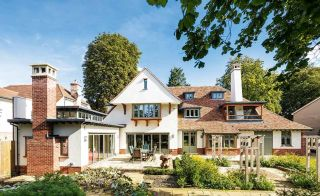 arts and crafts style self build with dormer windows