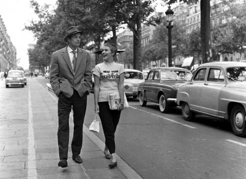 Breathless - Jean Paul Belmondo & Jean Seberg stroll down the Champs Elysées in Jean-Luc Godard's classic film. Copyright Raymond Cauchetier, courtesy James Hyman Gallery.
