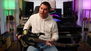 Music Is Win's Tyler Larson with Kirk Hammett's ESP Ouija Board guitar