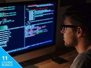 Man looking at a computer screen filled with code
