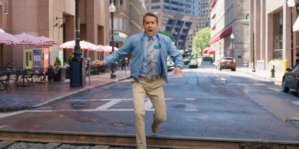Free Guy Ryan Reynolds steps onto the train tracks