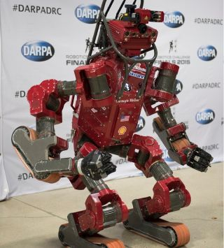 Team Tartan Rescue's CHIMP robot, from Carnegie Mellon University, took the lead on the first day of the DARPA robotics challenge.
