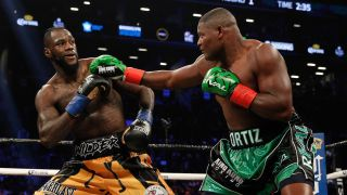 Wilder vs Ortiz rematch // Deontay Wilder (gold/black) defeated Luis Ortiz (green/black) ON MARCH 3, 2018, at the Barclays Center in Brooklyn, NY.