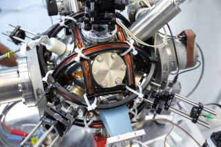 The atom interferometer tested whether there were extra forces acting on an atom.