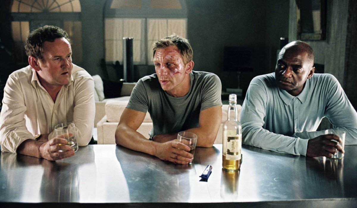 Colm Meany, Daniel Craig, and George Harris sit down for a drink in Layer Cake.