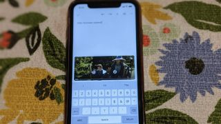 An iPhone with The Fellowship of the Ring on screen with Google Docs open