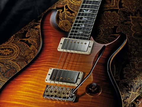 The body boasts a gorgeous flamed maple top.