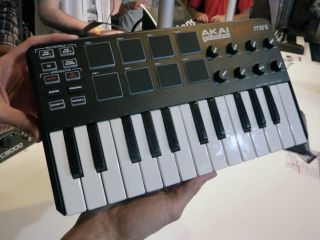The MPK mini quite literally with MusicRadar's hands on it.
