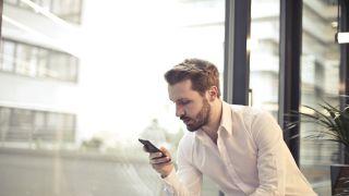Man speaks to smartphone