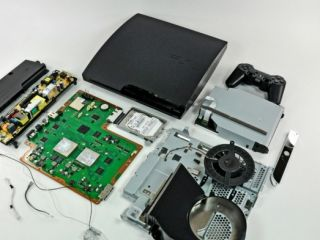 PS3 Slim torn to pieces