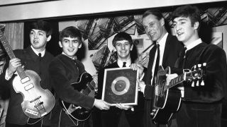 George Martin (second from right) with the Beatles in 1962.