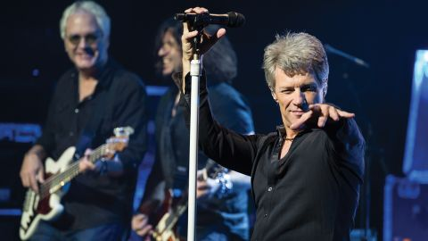 Jon Bon Jovi on stage pointing at the crowd