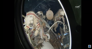 Cosmonauts install cable